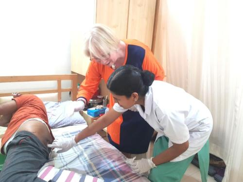 Dr. Renee Maschke and Sister Sobha doing bed sore management.