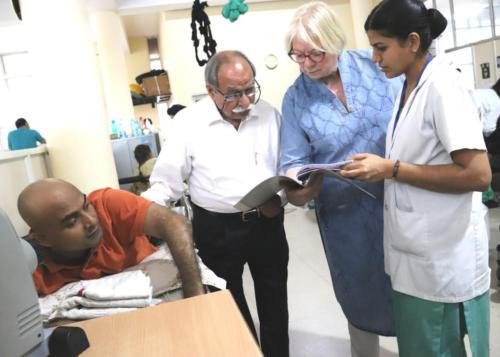 Dr. Renee Maschke, PMR from Germany, Dr. Col. Kapoor, Senior Urologist and Sister Sobha Head of Nursing -Chandigarh Spinal Rehab  discuss the report of a patient.